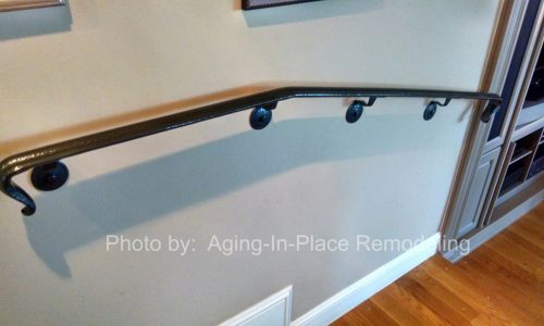 Custom fabricated handrail creates a safe transition between rooms