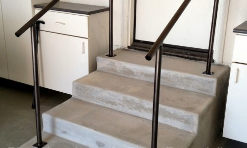 Custom fabricated handrails for garage entry