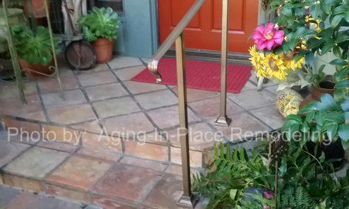 A custom fabricated entryway handrail