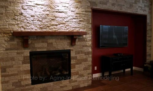 Custom stone wall with updated fireplace and custom mantel